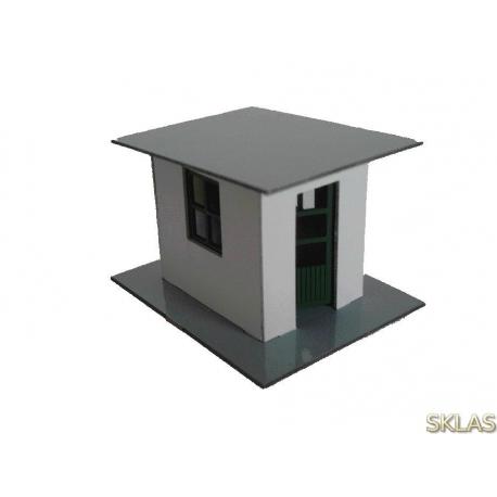 N - caseta de hormigón con puerta abatible